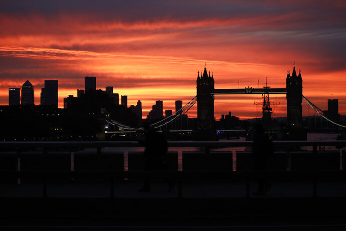 Tower Bridge and the skyscrapers of the Canary Wharf financial district, left, are seen at sunrise in London, Monday, Oct. 12, 2020.(AP Photo/Matt Dunham)