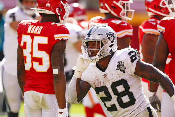 Las Vegas Raiders running back Josh Jacobs celebrates after scoring on a 7-yard touchdown run during the second half of an NFL football game against the Kansas City Chiefs, Sunday, Oct. 11, 2020, in Kansas City. (AP Photo/Charlie Riedel)
