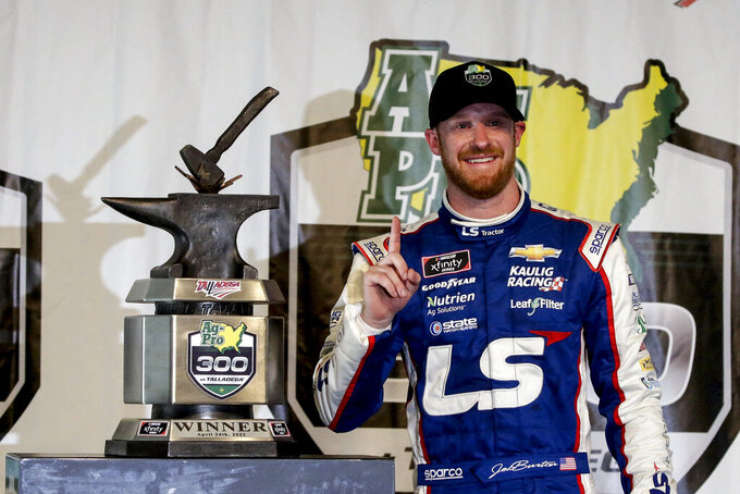 Jeb Burton smiles after winning the rain-shortened NASCAR Xfinity Series auto race at Talladega Superspeedway on Saturday, April 24, 2021, in Talladega, Ala. (AP Photo/Butch Dill)