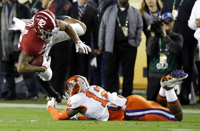 Clemson's K'Von Wallace stops Alabama's Irv Smith Jr. during the first half the NCAA college football playoff championship game, Monday, Jan. 7, 2019, in Santa Clara, Calif. (AP Photo/David J. Phillip)