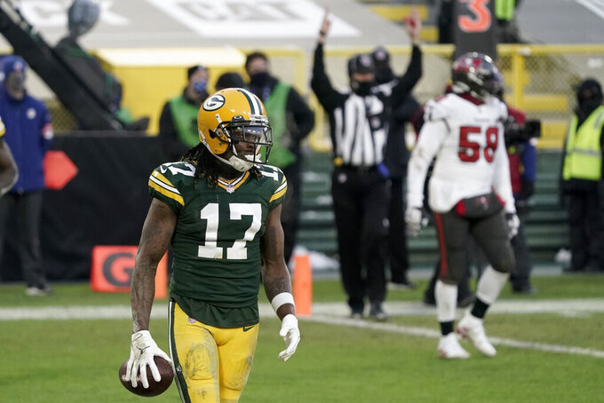 Green Bay Packers' Davante Adams reacts after his two-yard touchdown reception against the Tampa Bay Buccaneers during the second half of the NFC championship NFL football game in Green Bay, Wis., Sunday, Jan. 24, 2021. (AP Photo/Morry Gash)