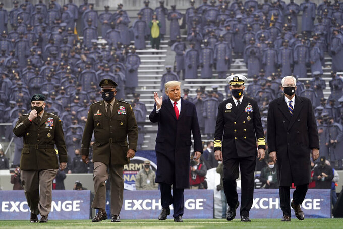 President Donald Trump waves as he walks on the field before the 121st Army-Navy Football Game in Michie Stadium at the United States Military Academy, Saturday, Dec. 12, 2020, in West Point, N.Y. (AP Photo/Andrew Harnik)