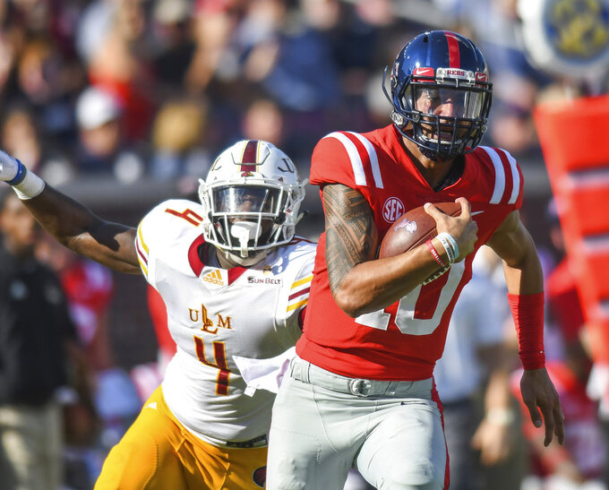 Mississippi quarterback Jordan Ta'amu (10) outruns Louisiana Monroe linebacker Rashaad Harding (4) to score during an NCAA college football game, Saturday, Oct. 6, 2018, at Vaught-Hemingway Stadium in Oxford, Miss. (Bruce Newman/The Oxford Eagle via AP)