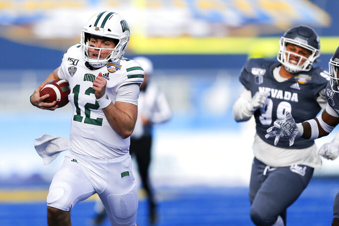 Ohio quarterback Nathan Rourke (12) breaks away from the Nevada defense for a 35-yard touchdown run during the first half of the Famous Idaho Potato Bowl NCAA college football game Friday, Jan. 3, 2020, in Boise, Idaho. (AP Photo/Steve Conner)