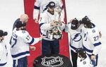 Tampa Bay Lightning's Victor Hedman (77) picks up the Prince of Wales trophy after the Lightning defeated the New York Islanders in overtime in Game 6 of the NHL hockey Eastern Conference final, Thursday, Sept. 17, 2020, in Edmonton, Alberta. (Jason Franson/The Canadian Press via AP)