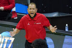 Houston head coach Kelvin Sampson yells to his players during the second half of a college basketball game against Rutgers in the second round of the NCAA tournament at Lucas Oil Stadium in Indianapolis Sunday, March 21, 2021. (AP Photo/Mark Humphrey)