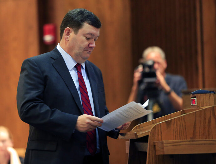 FILE - In this Tuesday, July 18, 2017 file photo, Kansas Solicitor General Stephen McAllister looks over his notes while making an argument before the Kansas Supreme Court in Topeka, Kan. Prosecutors in the U.S. attorney's office in Kansas City, Kan., improperly listened to recorded communications between inmates and their defense attorneys and willfully violated court orders during an independent investigation of the systemic practice, a judge said in a ruling on Tuesday, Aug. 13, 2019, that could upend hundreds of federal convictions and sentences. A spokesman for U.S. Attorney Stephen McAllister said their office is evaluating the court's findings and conclusions of law, and is not able to comment further. (AP Photo/Orlin Wagner, File)