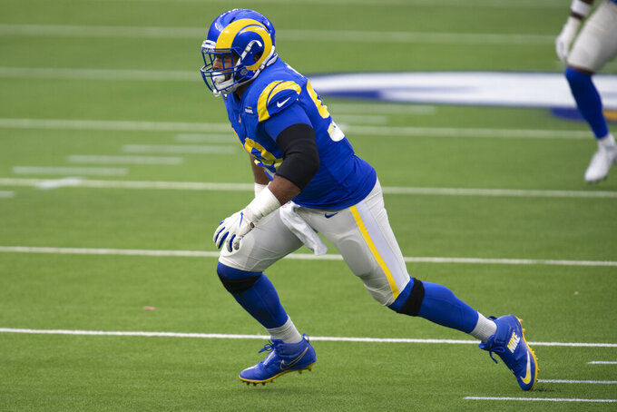 FILE - In this Jan. 3, 2021, file photo, Los Angeles Rams defensive tackle Aaron Donald (99) works against the Arizona Cardinals during an NFL football game in Inglewood, Calif. Donald took his third top Associated Press defensive player prize at the NFL Honors on Saturday, Feb. 6. (AP Photo/Kyusung Gong, File)