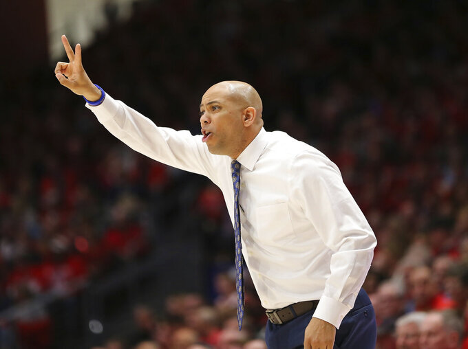 George Washington head coach Jamion Christian gestures during the first half of an NCAA college basketball game against Dayton, Saturday, March 7, 2020, in Dayton, Ohio. (AP Photo/Tony Tribble)