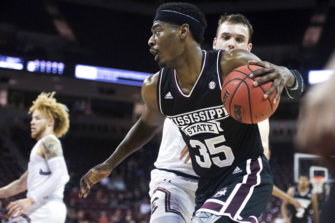 Mississippi State forward Aric Holman (35) drives against South Carolina forward Felipe Haase during the second half of an NCAA college basketball game Tuesday, Jan. 8, 2019, in Columbia, S.C. South Carolina won 87-82. (AP Photo/Sean Rayford)