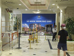 In this Monday, Aug. 19, 2019 photo, a University of Nevada, Reno student walks toward a security guard as renovation work continues in the lobby of the Circus Circus hotel-casino tower in downtown Reno, Nev., that will house roughly 1,300 UNR students after a July gas explosion shut down two major dorms. The non-gambling, non-smoking building that a subsidiary of Circus Circus leased to the university for $21.7 million has been converted into a residence hall exclusively for students through the 2019-2020 school year. (AP Photo/Scott Sonner)