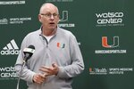 FILE - In this Oct. 22, 2019, file  photo, Miami NCAA college basketball head coach Jim Larranaga speaks to the media during NCAA college basketball media day in Coral Gables, Fla. The outbreak of the coronavirus brought the sports world — the whole world, really — to a screeching halt, and that includes the crucial recruiting period for college coaches that were putting the finishing touches on their 2020 classes while laying the all-important groundwork for next year's classes.(Carl Juste/Miami Herald via AP, File)
