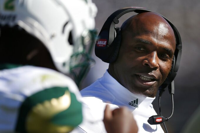 South Florida head coach Charlie Strong talks with quarterback Jordan McCloud during the first half of an NCAA college football game against Connecticut in East Hartford, Conn., Saturday, Oct. 5, 2019. (AP Photo/Michael Dwyer)
