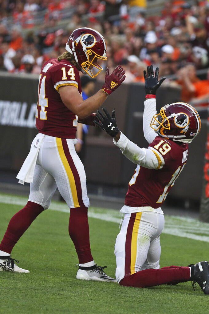 Washington Redskins wide receiver Robert Davis (19) celebrates with wide receiver Trey Quinn (14) after Davis scored a 46-yard touchdown during the first half of the team's NFL preseason football game against the Cleveland Browns, Thursday, Aug. 8, 2019, in Cleveland. (AP Photo/Ron Schwane)