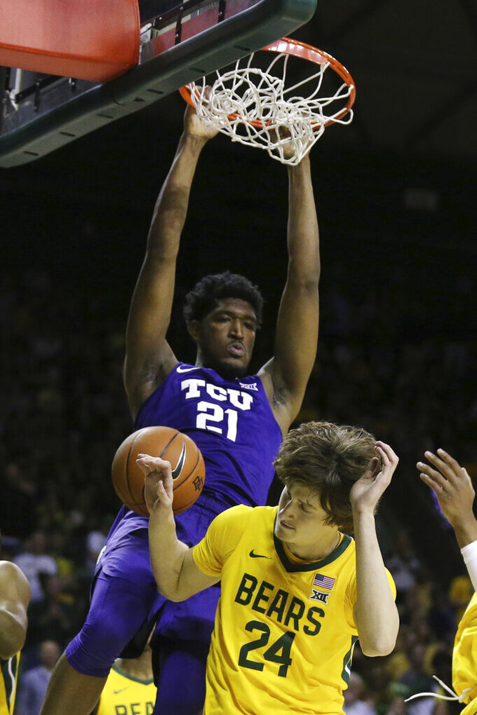 TCU center Kevin Samuel scores over Baylor guard Matthew Mayer in the first half of an NCAA college basketball game, Saturday, Feb. 1, 2020, in Waco, Texas. (AP Photo/Rod Aydelotte)