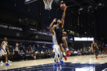 Northeastern guard Max Boursiquot (14) goes to the basket past Hofstra forward Kevin Schutte during the first half of an NCAA college basketball game for the championship of the Colonial Athletic Association men's tournament Tuesday, March 10, 2020, in Washington. (AP Photo/Nick Wass)