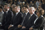 Edmonton Mayor Don Iveson, Alberta Premier Jason Kenney, Prime Minister Justin Trudeau and University of Alberta President David Turpin listens to a speech during a memorial for the victims of the recent Ukrainian plane crash in Iran, in Edmonton, Sunday, Jan. 12, 2020. (Todd Korol/The Canadian Press via AP)