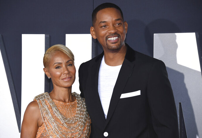 FILE - In this Oct. 6, 2019 file photo, Jada Pinkett Smith, left, and her husband Will Smith attend the premiere of