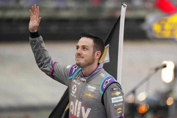 Alex Bowman waves to fans before a NASCAR Cup Series auto race at Bristol Motor Speedway Saturday, Sept. 18, 2021, in Bristol, Tenn. (AP Photo/Mark Humphrey)