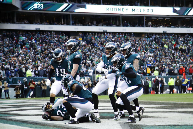Philadelphia Eagles' Rodney McLeod (23) celebrates with teammates after intercepting a pass during the second half of an NFL football game against the Seattle Seahawks, Sunday, Nov. 24, 2019, in Philadelphia. (AP Photo/Matt Rourke)
