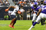 Chicago Bears running back David Montgomery (32) runs with the ball as Minnesota Vikings defensive end Everson Griffen (97) defends during the second half of an NFL football game Sunday, Sept. 29, 2019, in Chicago. (AP Photo/Matt Marton)
