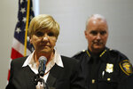 FILE - In this Oct. 14, 2019 file photo, Mayor Betsy Price speaks accompanied by interim police chief Ed Kraus at a news conference in Fort Worth, Texas, about former Fort Worth Police officer Aaron Dean shooting Atatiana Jefferson, 28, through a back window of her home in the early hours Saturday, Oct. 12, after a neighbor reported her front door was left open. (AP Photo/David Kent, File)