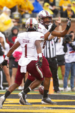 Troy wide receiver Khalil McClain, right, celebrates his touchdown with teammate Kaylon Geiger, left, during the first half of an NCAA college football game against Missouri Saturday, Oct. 5, 2019, in Columbia, Mo. (AP Photo/L.G. Patterson)