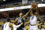 Wofford 's Messiah Jones (25) and Missouri's Mark Smith (13) reach for a rebound as Missouri's Xavier Pinson (1) watches during the first half of an NCAA college basketball game Monday, Nov. 18, 2019, in Columbia, Mo. (AP Photo/Jeff Roberson)