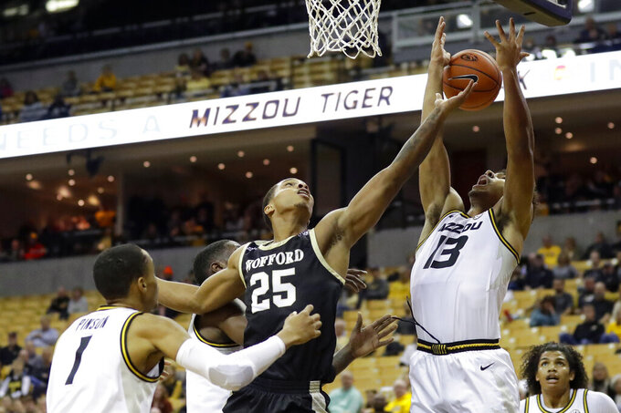 Missouri uses stingy defense to smother Wofford 75-56