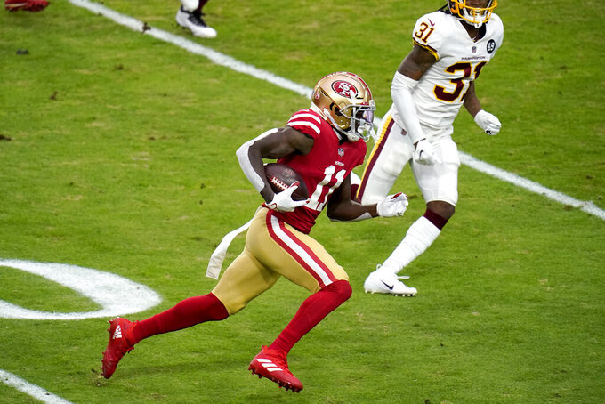 San Francisco 49ers wide receiver Brandon Aiyuk (11) runs as Washington Football Team strong safety Kamren Curl (31) defends during the first half of an NFL football game, Sunday, Dec. 13, 2020, in Glendale, Ariz. (AP Photo/Ross D. Franklin)