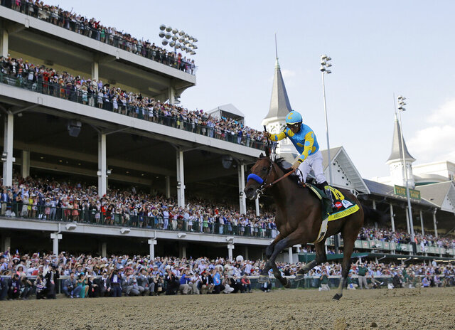 FILE - In this May 2, 2015, file photo, Victor Espinoza rides American Pharoah to victory in the 141st running of the Kentucky Derby horse race at Churchill Downs in Louisville, Ky. American Pharaoh went on to win the Triple Crown a few weeks later. More than a dozen thoroughbreds had come up a race short of becoming racing's first Triple Crown winner since Affirmed in 1978, until American Pharoah ended the 37-year drought in 2015. (AP Photo/David J. Phillip, File)