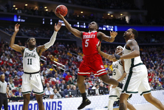 Bradley guard Darrell Brown (5) drives to the basket between Michigan State's Aaron Henry, left, and Nick Ward, right, during a first round men's college basketball game in the NCAA Tournament, Thursday, March 21, 2019, in Des Moines, Iowa. (AP Photo/Charlie Neibergall)