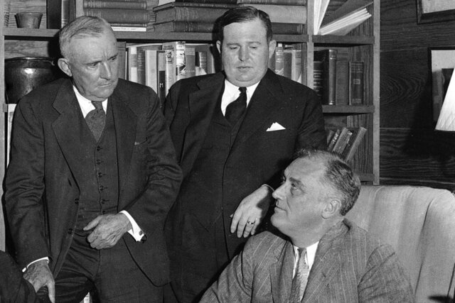 FILE- In this Nov. 20, 1934, President Franklin D. Roosevelt, right, meets with officials from southern states, including Alabama Gov.-elect Bibb Graves, left, Florida Gov. David Sholtz, in the president's study at the Little White House in Warm Springs, Ga. Historically black Alabama State University on Wednesday, Oct. 15, 2020, has removed the name of Graves, once the leader of a Ku Klux Klan chapter, from a campus dormitory following a decision by trustees that occurred during the national discussion prompted by the police killing of George Floyd in Minnesota. (AP Photo/File)