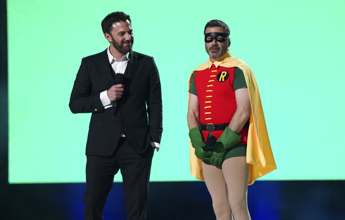 """Ben Affleck and Jimmy Kimmel speak at """"Vax Live: The Concert to Reunite the World"""" on Sunday, May 2, 2021, at SoFi Stadium in Inglewood, Calif. (Photo by Jordan Strauss/Invision/AP)"""
