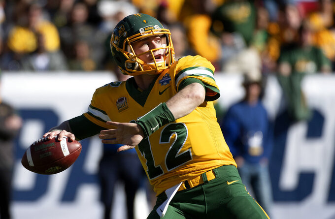 North Dakota State quarterback Easton Stick (12) winds up to throw a 78-yard touchdown pass against Eastern Washington during the second half of the FCS championship NCAA college football game, Saturday, Jan. 5, 2019, in Frisco, Texas. (AP Photo/Jeffrey McWhorter)