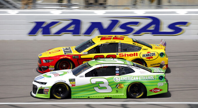 Drivers Joey Logano (22) and Austin Dillon (3) practice for the NASCAR Cup Series auto race at Kansas Speedway in Kansas City, Kan., Friday, May 10, 2019. (AP Photo/Colin E. Braley)