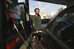 A man fills his car at a gas station in Tehran, Iran, Friday, Nov. 15, 2019. Authorities have imposed rationing and increased the prices of fuel. The decision came following months of speculations about possible rationing after the U.S. in 2018 reimposed sanctions that sent Iran's economy into free-fall following Washington withdrawal from 2015 nuclear deal between Iran and world powers. (AP Photo/Vahid Salemi)