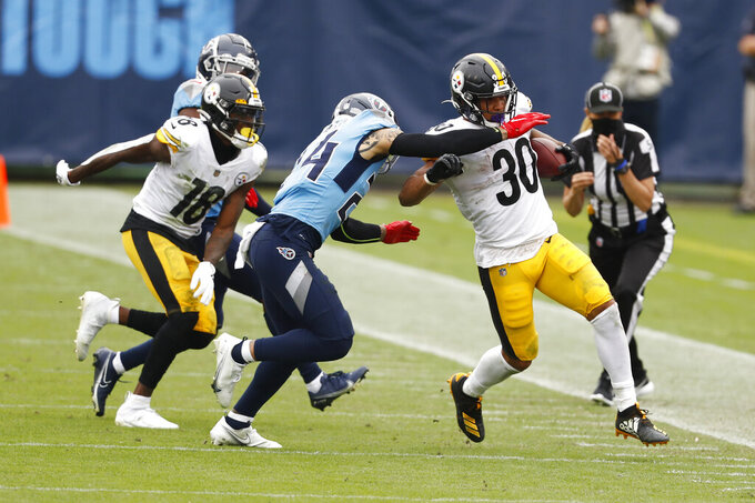 Pittsburgh Steelers running back James Conner (30) tries to get past Tennessee Titans strong safety Kenny Vaccaro (24) in the second half of an NFL football game Sunday, Oct. 25, 2020, in Nashville, Tenn. (AP Photo/Wade Payne)