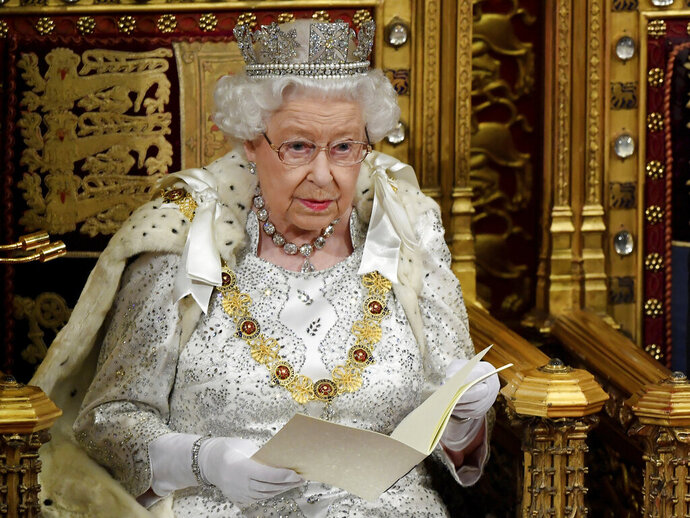 Britain's Queen Elizabeth II delivers the Queen's Speech during the official State Opening of Parliament in London, Monday Oct. 14, 2019. (Toby Melville/Pool via AP)