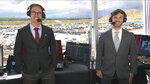 In this still image from video, NASCAR drivers Joey Logano, left, and Daniel Suarez pose at Phoenix Raceway in Avondale, Ariz., where they we're the Fox Sports co-analysts for the Xfinity Series auto race on Saturday, March 13, 2021.  Suarez is the first Mexican analyst used in the broadcast of a NASCAR national series race and called a lap in his native Spanish. (Fox Sports via AP)