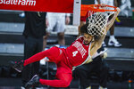Ohio State guard Duane Washington Jr. (4) follows through on a dunk against Purdue in the first half of an NCAA college basketball game at the Big Ten Conference tournament in Indianapolis, Friday, March 12, 2021. (AP Photo/Michael Conroy)
