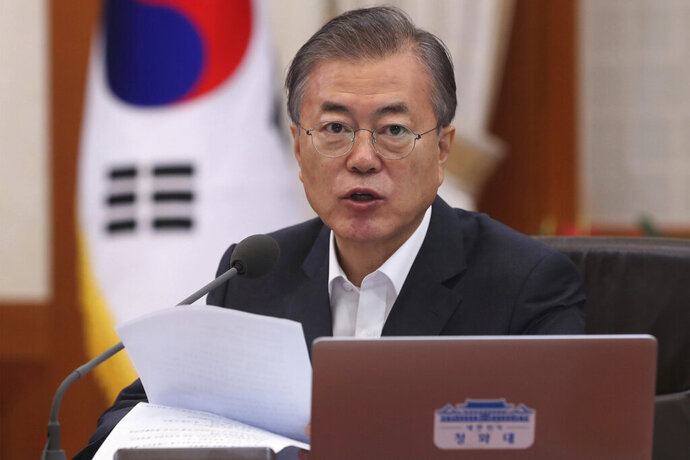 South Korean President Moon Jae-in speaks during a Cabinet meeting at the presidential Blue House in Seoul, South Korea, Thursday, Aug. 29, 2019. Moon has berated Japan for carrying out its plan to downgrade South Korea's trade status and reiterated Seoul's stance that Tokyo was weaponizing trade to retaliate over political rows stemming from the countries' wartime history. (Han Sang-kyun/Yonhap via AP)