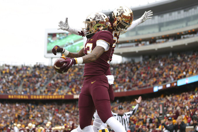 Minnesota wide receiver Rashod Bateman and teammate wide receiver Tyler Johnson celebrate after scoring a touchdown against Iowa during an NCAA college football game Saturday, Oct. 6, 2018, in Minneapolis. (AP Photo/Stacy Bengs)