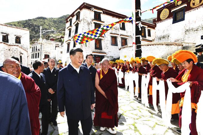 In this photo released by Xinhua News Agency, Chinese President Xi Jinping, visits the Drepung Monastery located in the western suburbs of Lhasa, southwestern China's Tibet Autonomous Region on Thursday, July 22, 2021. Xi visited the Tibet Autonomous Region from Wednesday to Friday. Chinese leader Xi Jinping has made a rare visit to Tibet as authorities tighten controls over the Himalayan region's traditional Buddhist culture, accompanied by an accelerated drive for economic development. (Xie Huanchi/Xinhua via AP)