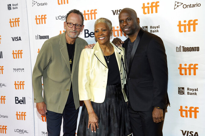 """Singer Dionne Warwick, center, subject of """"Dionne Warwick: Don't Make Me Over,"""" poses with co-directors David Heilbroner, left, and Dave Wooley at the premiere of the documentary film at the 2021 Toronto International Film Festival, Saturday, Sept. 11, 2021, in Toronto. (AP Photo/Chris Pizzello)"""