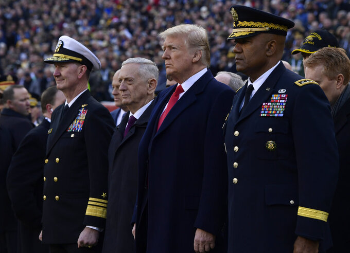 President Donald Trump, center, stands with Defense Secretary Jim Mattis, second from left, during pregame ceremonies at the Army-Navy NCAA college football game in Philadelphia, Saturday, Dec. 8, 2018. (AP Photo/Susan Walsh)