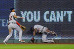 Detroit Tigers center fielder Victor Reyes (22) and right fielder Daz Cameron (41) try to field an RBI double hit by Kansas City Royals' Jorge Soler during the sixth inning of a baseball game Thursday, Sept. 24, 2020, in Kansas City, Mo. (AP Photo/Charlie Riedel)