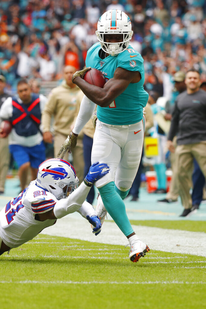 Buffalo Bills free safety Jordan Poyer (21) takes a hold of Miami Dolphins wide receiver DeVante Parker (11), during the first half at an NFL football game, Sunday, Nov. 17, 2019, in Miami Gardens, Fla. (AP Photo/Wilfredo Lee)