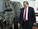 Attorney General William Barr leaves his home in McLean, Va., on Thursday, March 21, 2019.  Special Counsel Robert Mueller is expected to present a report to the Justice Department any day now outlining the findings of his nearly two-year investigation into Russian election meddling, possible collusion with Trump campaign officials and possible obstruction of justice by Trump . (AP Photo/Jose Luis Magana)