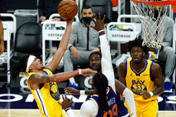 Golden State Warriors guard Damion Lee (1) drives past Phoenix Suns forward Jae Crowder (99) during the first half of an NBA basketball game, Thursday, March 4, 2021, in Phoenix. (AP Photo/Rick Scuteri)